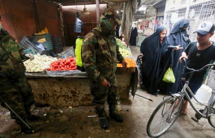 العراق يلوح بفرض الحظر الشامل على خلفية زيادة الإصابات