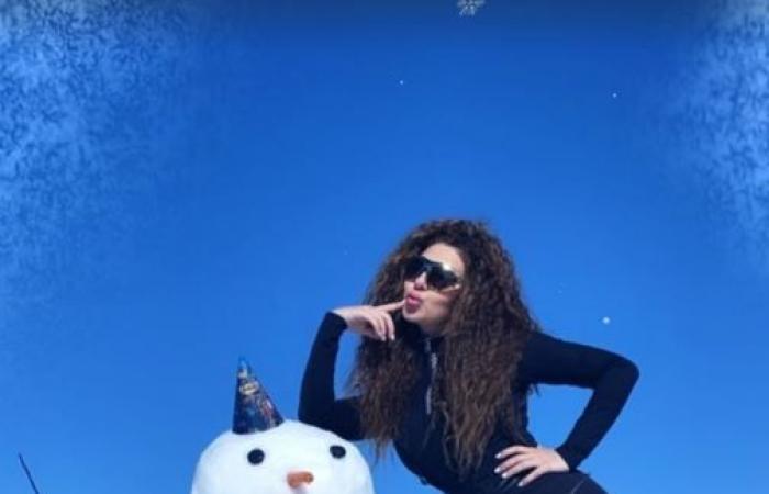 ميريام فارس تستمع بالثلوج بصحبة ابنها × 10 صور