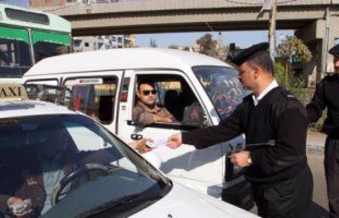 حملات مرورية بمحاور القاهرة والجيزة لرصد مخالفات السيارات