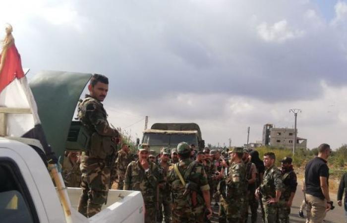 مسلحو أكبر مدن ريف درعا يسلمون أسلحتهم للجيش السوري... صور