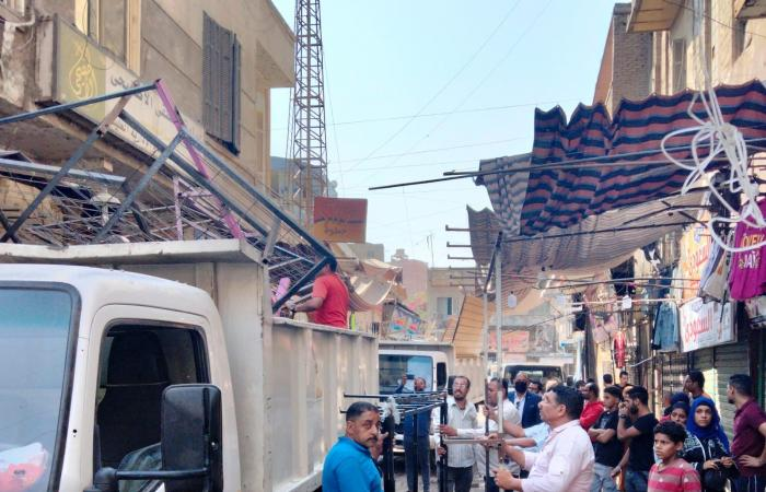 حملة لرفع الإشغالات بشوارع الصناديلي وسعد زغلول وأحمد ماهر بميدان الجيزة